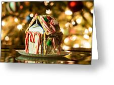 Gingerbread House Against A Background Of Christmas Tree Lights Greeting Card