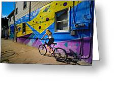 Girl Rides Bicycle Past Mural On The South Side Of Pittsburgh Greeting Card by Amy Cicconi
