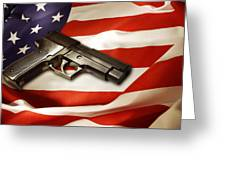 Gun On Flag Greeting Card by Les Cunliffe