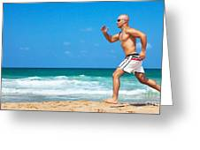 Healthy Man Running On The Beach Greeting Card