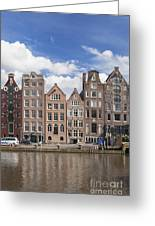 Historic Buildings Along The Damrak Canal In Amsterdam Greeting Card
