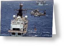 Hms Cornwall Is Pictured Receiving Stores By Merlin Helicopter  Greeting Card