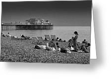 Holiday Makers On Brighton Beach Greeting Card