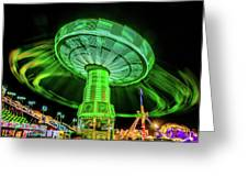 Illuminated Fair Ride With Blurred Neon Greeting Card