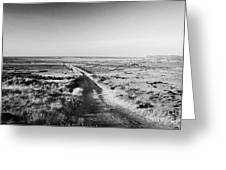 isolated single track road over peat bog heading down to the sea Gweedore county Donegal Republic of Ireland Greeting Card