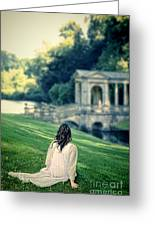 Lady Sitting On A Hill Above A Lake Greeting Card