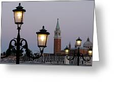 Lampposts Lit Up At Dusk With Building Greeting Card