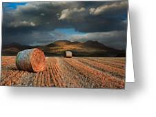 Landscape Of Hay Bales In Front Of Mountain Range With Dramatic  Greeting Card