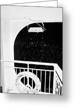 lifebelt on board the hurtigruten ship ms midnatsol at night in winter in Tromso troms Norway europe Greeting Card