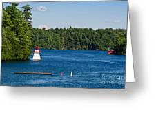 Lighthouse And Boathouse Greeting Card