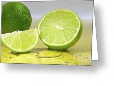 Limes On Yellow Surface Greeting Card
