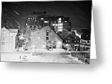 looking out atTromso bryggen quay harbour on a cold snowy winter night troms Norway europe Greeting Card