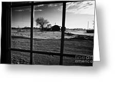 looking out through door window to snow covered scene in small rural village of Forget Saskatchewan  Greeting Card by Joe Fox