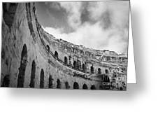 Looking Up At Blue Cloudy Sky And Upper Tiers Of The Old Roman Colloseum At El Jem Tunisia Greeting Card