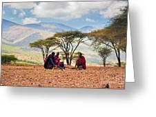 Maasai Men Sitting. Savannah Landscape In Tanzania Greeting Card
