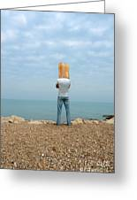 Man By The Sea With Bag On His Head Greeting Card