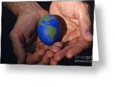 Man Holding Earth Egg Greeting Card by Jim Corwin