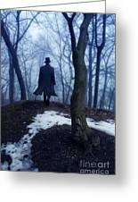 Man In Top Hat Walking Through Foggy Woods Greeting Card