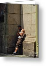 Man Leaning Against Wall In Sun Greeting Card