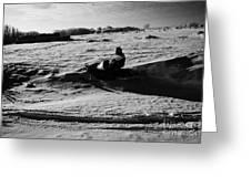 man on snowmobile crossing frozen fields in rural Forget Saskatchewan Canada Greeting Card