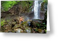 Man Standing On Rocks Near Waterfall Greeting Card