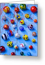 Marbles On Blue Board Greeting Card