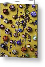 Marbles On Yellow Wooden Table Greeting Card