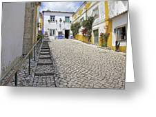 Medieval Cobblestone Street In The Fortified Walled European Village Of Obidos Greeting Card