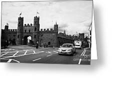 modern traffic driving past Entrance to Macroom Castle County Cork Ireland Greeting Card