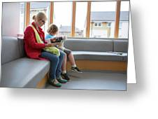 Mother And Son In Waiting Room Greeting Card