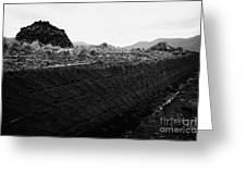 mound of Turf peat cut next to the cut seam in a peat bog in Connemara Greeting Card
