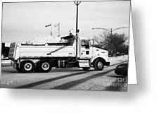 municipal city dump truck taking away snow cleared from parking lots and roads in Saskatoon Saskatch Greeting Card