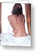 Naked Back Of A Woman Sitting On A Bed Greeting Card