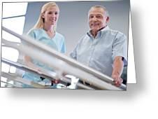 Nurse With Senior Man Using Parallel Walking Bars Greeting Card