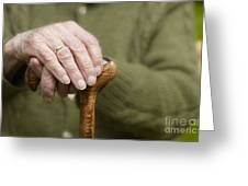 Old Hands Of A Senior On Walking Stick Greeting Card
