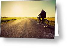 Old Man Riding A Bike To Sunny Sunset Sky Greeting Card