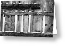 old patched up wooden fence using old bits of wood in snow Forget Greeting Card