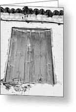 old weathered brown wooden door double window opening on abandoned house with cracked stucco yellow walls in Tacoronte Tenerife Canary Islands Spain Greeting Card
