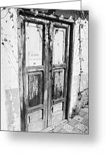 old weathered brown wooden door entrance to abandoned house with cracked stucco walls and for sale sign in spanish in Tacoronte Tenerife Canary Islands Spain Greeting Card