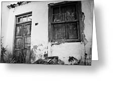 old weathered wooden door entrance to abandoned house 18 with window and cracked stucco walls in Los Banquitos Tenerife Canary Islands Spain Greeting Card