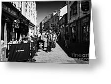 pedestrians and drinkers enjoying a sunday afternoon drink in the bunch of grapes pub high street Ga Greeting Card