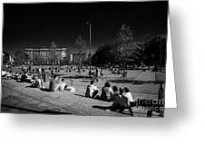 people sitting enjoying the sunshine Eyre Square in the heart of Galway city county Galway Republic of Ireland Greeting Card