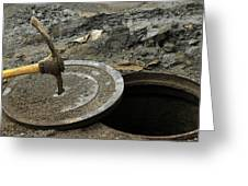 Pick Axe In A Man Hole Cover Greeting Card