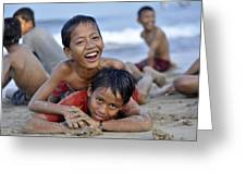 Playing On The Beach Greeting Card by Achmad Bachtiar