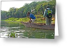 Poling A Dugout Canoe In The Rapti River In Chitwan National Park-nepal Greeting Card