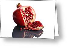Pomegranate Opened Up On Reflective Surface Greeting Card