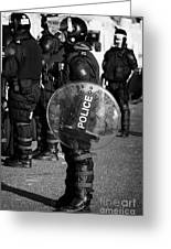 Psni Officer In Full Riot Gear With Shield On Crumlin Road At Ardoyne Shops Belfast 12th July Greeting Card by Joe Fox