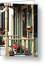 Pumpkins On The Porch Greeting Card by John Rizzuto