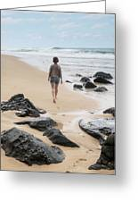 Rear View Of Woman Walking On Beach Greeting Card
