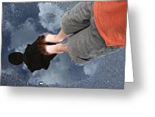Reflection Of Boy In A Puddle Of Water Greeting Card